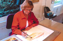 Mary Blain working on an original watercolor painting.